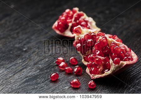 pomegranate on black wooden background