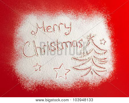 Written words Merry christmas on a snow field, new year concept. Christmas card.