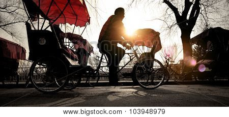Man Riding a Rickshaw Chinese Occupation Driving Concept