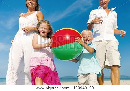 Family playing on the beach Enjoyment Concept