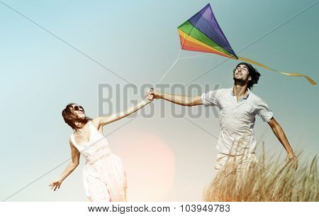 Couple Beach Holiday Flying Kite Sea Togetherness Concept