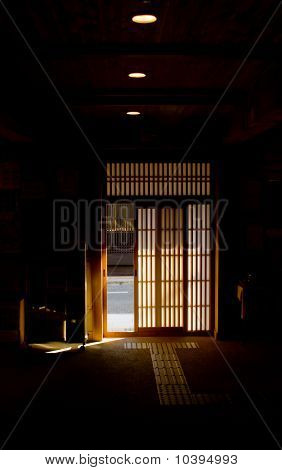 Japanese Exterior Sliding Door In Darkened Interior