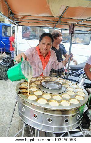 Street Food Vendor Baking Biscuits