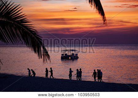 Sunset Walk On The Beach