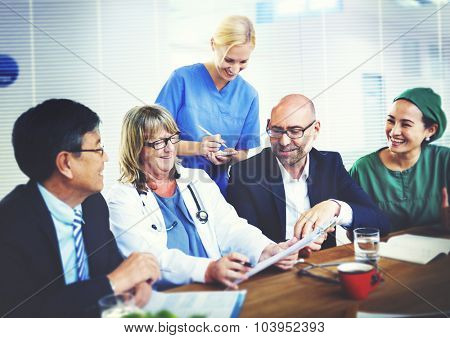 Group Of General Practitioners Having A Meeting Concept