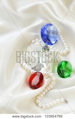 colored glass diamonds on a soft silk background