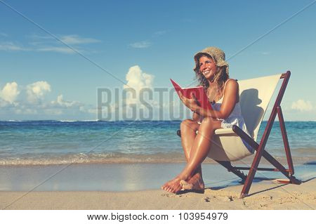 Woman Relaxing on the Beach Tranquil Tropical Concept