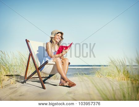 Woman Reading Book at Beach Relaxation Concept