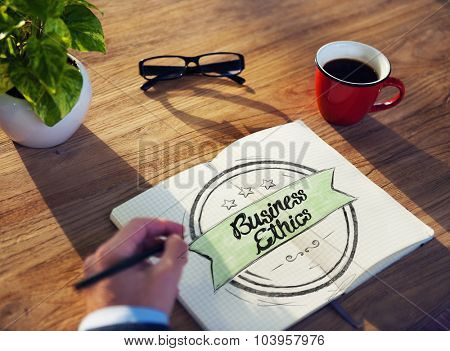 Man and Notepad with Business Ethics Concept