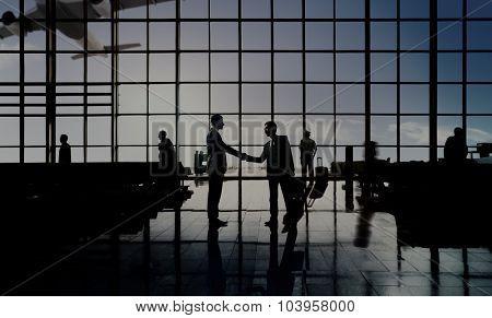 Businessmen Handshake Deal Airport Terminal Concept