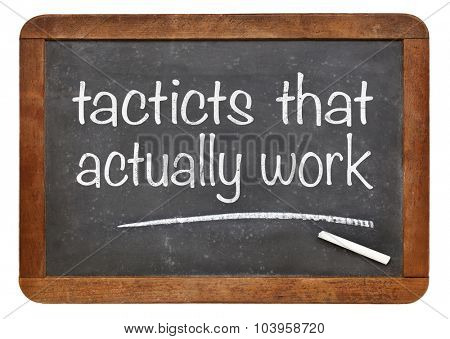 Tactics that actutally work - white chalk text  on a vintage slate blackboard