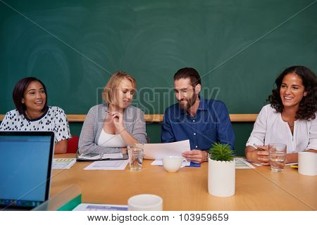 coworkers meeting in boardroom to discuss ideas for company productivity