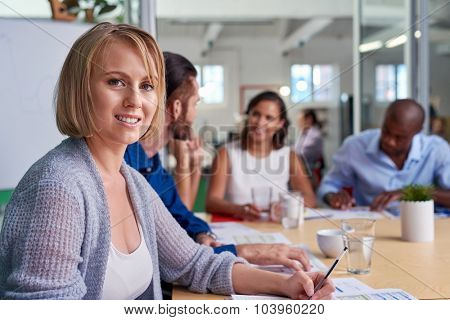 portrait of professional business woman during boardroom meeting with coworkers