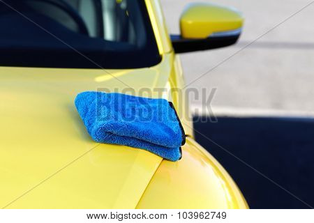 Car with wax and polish cloth. Waxing and polishing.