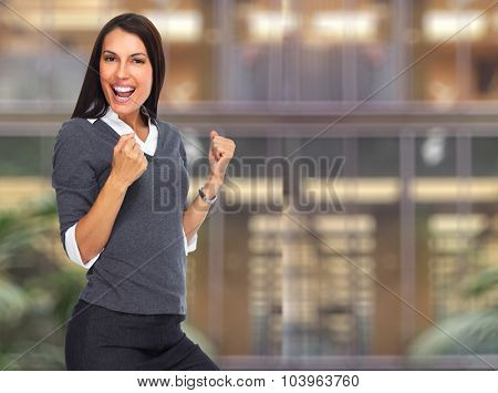 Happy excited woman portrait over office background.