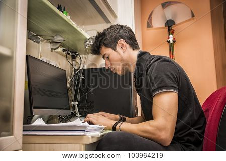 Young Man with Doing Homework at Computer Desk