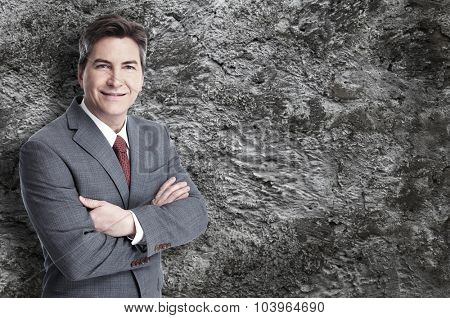 Executive businessman over grey wall background.