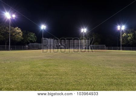 Empty Baseball Field At Night With The Lights On