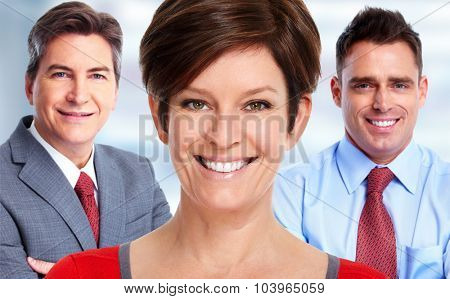 Beautiful mature woman and a business team. Accounting and finance.
