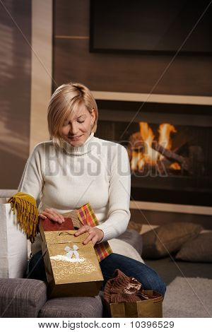 Woman At Home With Shopping Bags