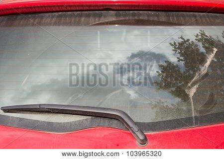 Windshield Wiper On Dirty Back Glass Of Car
