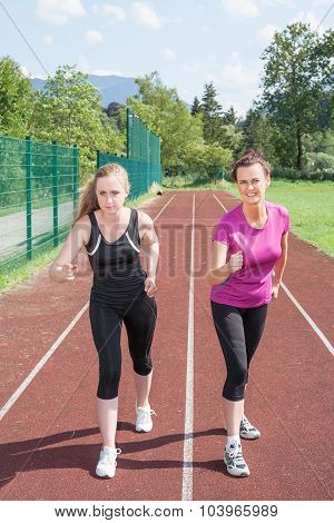 Two Women Ready To Race On Running Track