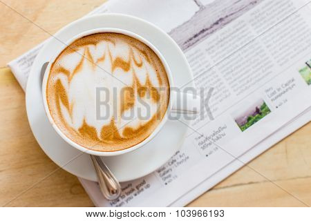 Hot Latte Art Coffee Cup With Newspaper On Wooden Table, Vintage And Retro Style.