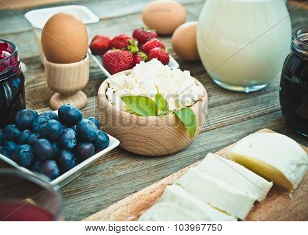 Summer breakfast. fruit and dairy products on a wooden table