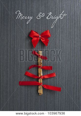 Christmas Tree Card made of red ribbons , isolated on black wallpaper background