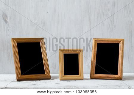 photo frames on old white table