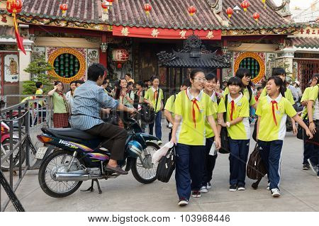 HO CHI MINH, VIETNAM, FEBRUARY 24 , 2015: Vietnamese students in Chinese language are leaving school at the Ong Bon Pagoda, in Chinatown, district 5 of Ho Chi Minh Ville, (Saigon), Vietnam.