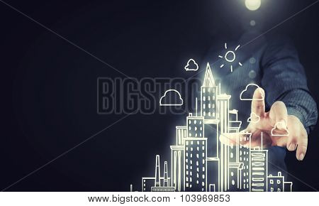 Businessperson touching media screen with construction model