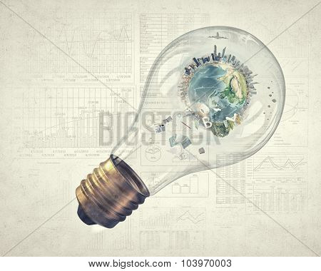 Glass light bulb and Earth planet inside. Elements of this image are furnished by NASA
