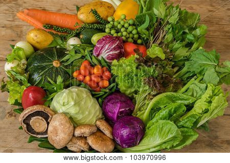 Various colorful raw vegetables in the banana leaf basket.
