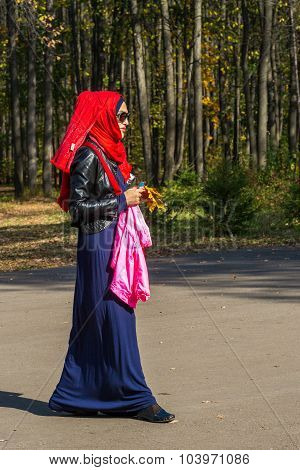 Muslim Woman Dressed In Bright Clothes