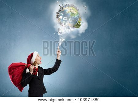 Santa woman with red bag on back pointing up with finger. Elements of this image are furnished by NASA