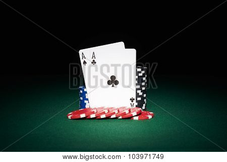 Poker Chips On Table With Aces Cards