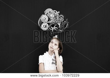 Cute thoughtful school girl and gear mechanism above her head