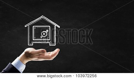Businessman hand holding chalk drawn safe concept