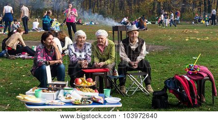 Group Of Russian Pensioners In A Park