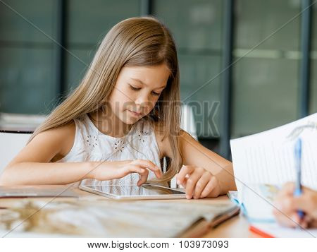Girl doing her homework in library