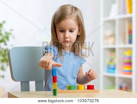 little child kid playing with building blocks