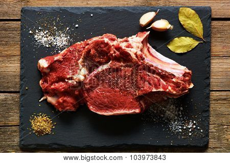 Raw beef meat over slate