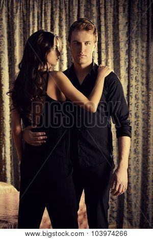 Beautiful couple in love in bedroom. Luxury.