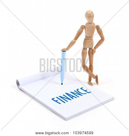 Wooden Mannequin Writing - Finance