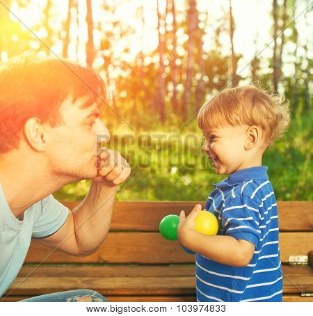 Father and son having fun outdoors