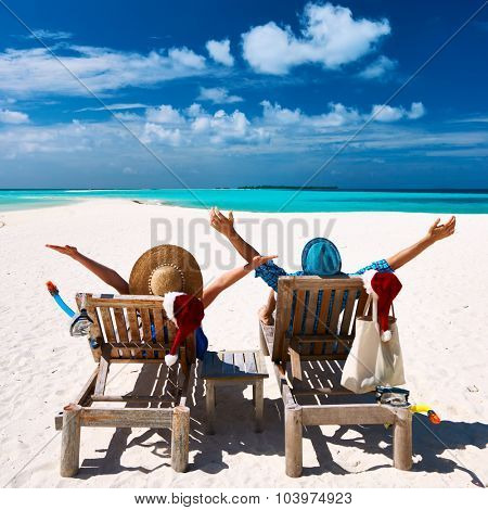 Couple relax on a tropical beach at christmas