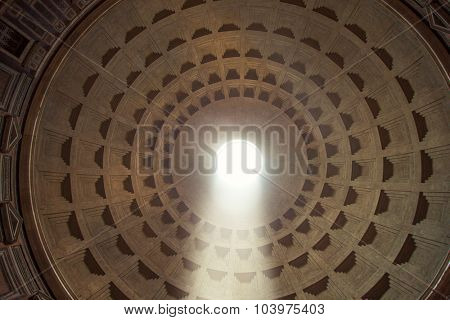 Pantheons dome indoors. Ray of sunlight passing through a hole in the ceiling