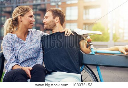 Loving Couple Sitting On Bench