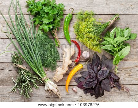 Fresh garden herbs and spices on wooden table. Top view